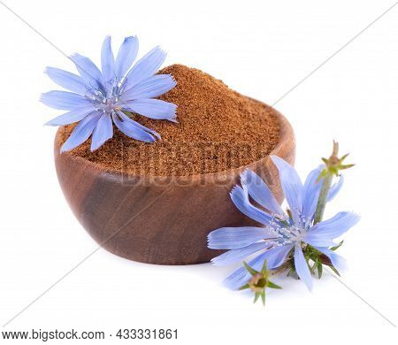 Chicory Powder And Flower In Wooden Bowl, Isolated On White Background. Cichorium Intybus.