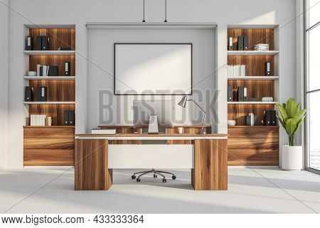 Office Room Interior With Empty White Poster, Panoramic Window, Desktop, Armchairs, Wall, Desk, Book