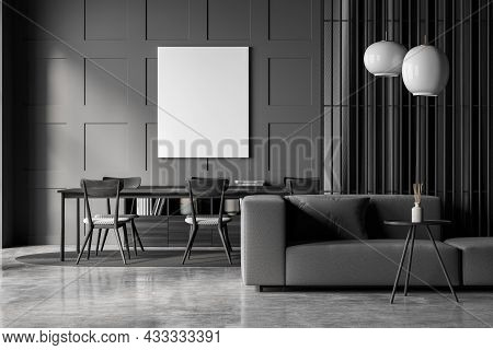 Empty Canvas On The Wall Of The Dark Grey Living Space Interior With A Sofa, A Partition With A Curt