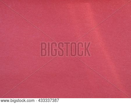 Light Beam On A Red Smooth Texture, Pale Red Background With An Empty Place For Copying, Unpleasued