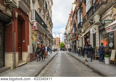 Seville, Spain - 06 April, 2019: View Of The Street In The Historical Centre Of Seville, A Big Touri