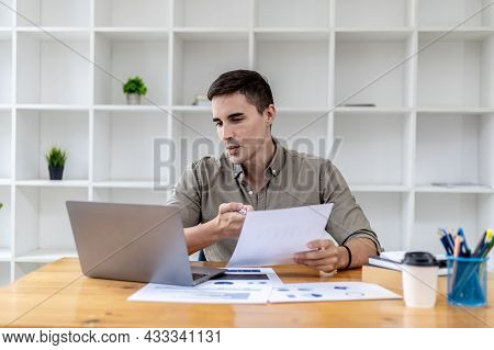 A Young Businessman Is Discussing A Laptop Video Conference With A Business Partner Who Founded A St