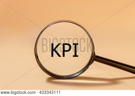 Kpi Inscription In Black Letters On A Magnifying Glass. Key Performance Indicator Concept.