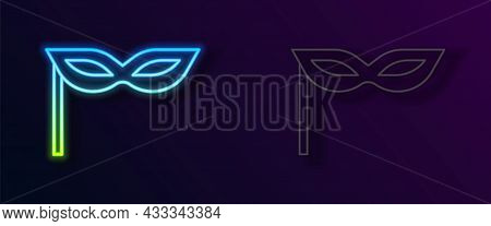 Glowing Neon Line Carnival Mask Icon Isolated On Black Background. Masquerade Party Mask. Vector