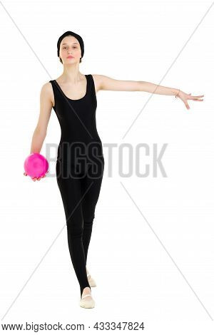 Front View Portrait Of Teenage Girl Gymnast. Beautiful Girl Doing Gymnastic Exercise With Pink Ball.