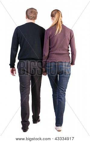 Back view of walking  young couple. young husband and wife. going beautiful friendly girl and guy in shorts together. Rear view people collection. side view erson.Isolated over white background