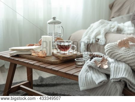 Cozy Home Still Life With A Cup Of Tea And Details Of Autumn Home Decor.