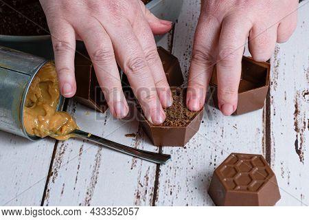 Confectioner Finishing A Small Brazilian Honey Cake, Next To A Tin Of Dulce De Leche.