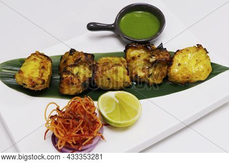 Clay Oven Roasted Ajwain Flavored Fish Cubes, Coated With Gram Flour, Yoghurt And Spices, Known As T