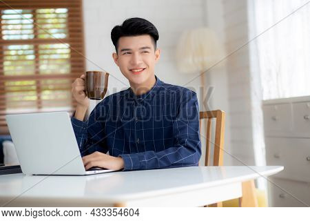 Young Business Man Working From Home With Laptop Computer On Desk, Freelance Male Sitting Stay Home