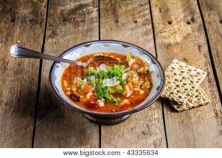 Minestrone vegetable soup with parmesan cheese ( Italian )