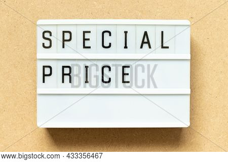 Lightbox With Word Special Price On Wood Background