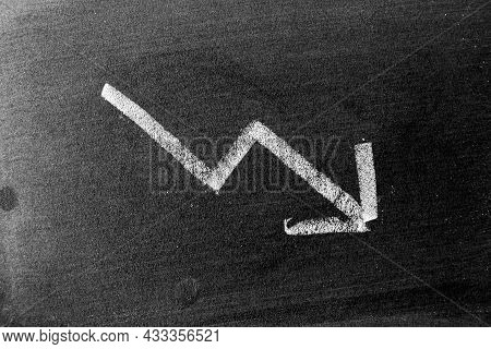 White Chalk Hand Drawing In Arrow Down Shape On Blackboard Or Chalkboard Background (concept Of Stoc
