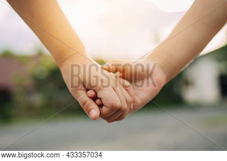 Close Up Of Children Hand Holding Together. Concept For Together Love And Bonding Of Sibling In Fami