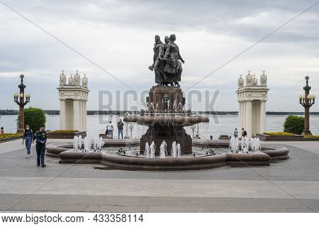 Monument Fountain With Dancing Women On The Volga River Embankment In Volgograd In Russia. Cloudy Da