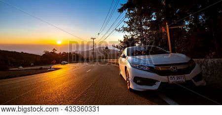 Chiang Mai, Thailand - February 17, 2018: Tourists Park Their Cars On Doi Inthanon Viewpoint At Sunr