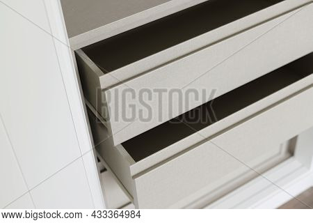 Open White Drawers Of A Built-in Closet