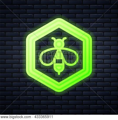 Glowing Neon Bee And Honeycomb Icon Isolated On Brick Wall Background. Honey Cells. Honeybee Or Apis