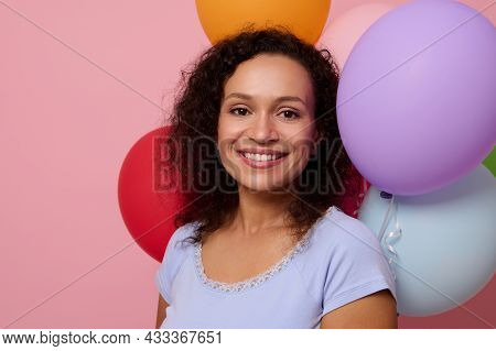Close-up Of Attractive Happy Cheerful Mixed Race Woman Smiling With A Beautiful Toothy Smile Looking