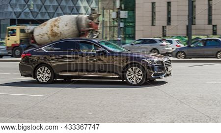 Moscow, Russia - August 2021: Genesis G80 Rides On The City Road. Premium Sedan Car Rushes Along The