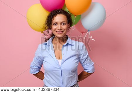 Beautiful Middle Aged Mixed Race Stunning Woman In Blue Shirt Smiling With Toothy Smile Looking At T