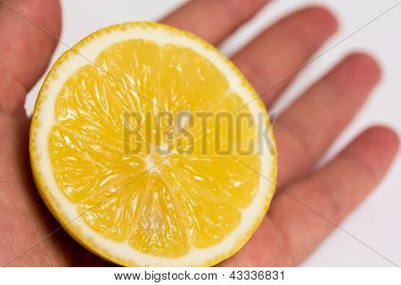 Half Of A Lemon In A Hand