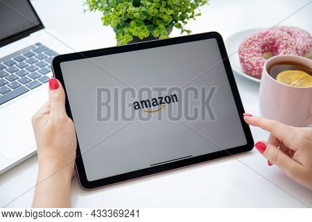 Alanya, Turkey - August 6, 2021: Woman Holding Apple Ipad Air With Online Shopping Service Amazon On