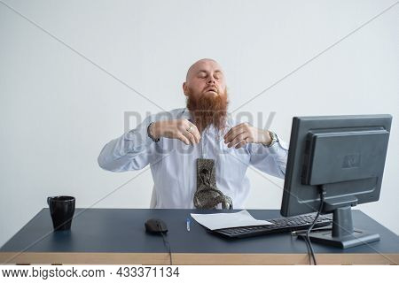 Problems For The Office Worker. A Bald Man In A White Shirt Sits At A Desk With A Computer And Is St
