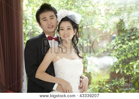 Couples Of Asian Groom And Bride In Wedding Suit