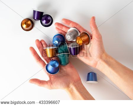 Women's Hands Hold Aluminum Capsules With Ground Coffee On A White Background. Modern Means Of Stori