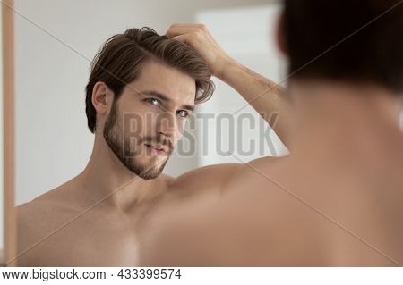 Man Looks In Mirror Touch Hair Feels Concerned Due Receding