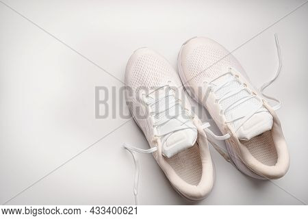 Flat Lay Sport With White Sport Shoes On White Background. Concept Healthy Lifestyle, Sport And Diet