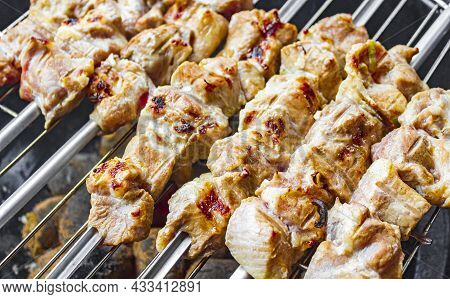 Russian Shashlik With Skewers On A White Plate Background.