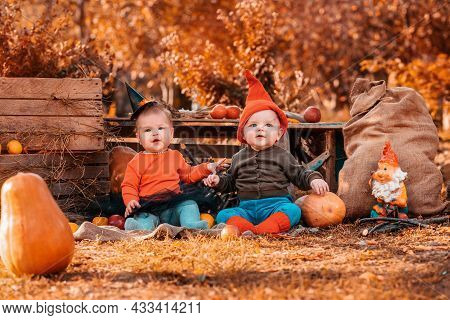 Halloween And Autumn Holidays. A Boy In A Dwarf Costume And A Girl In A Witch Costume. Outdoor. Pres
