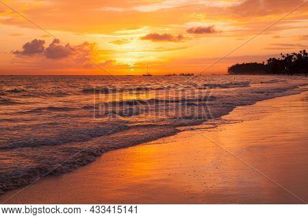 Bright Orange Sunrise Sky Over Atlantic Ocean. Bavaro Beach. Dominican Republic, Coastal Landscape
