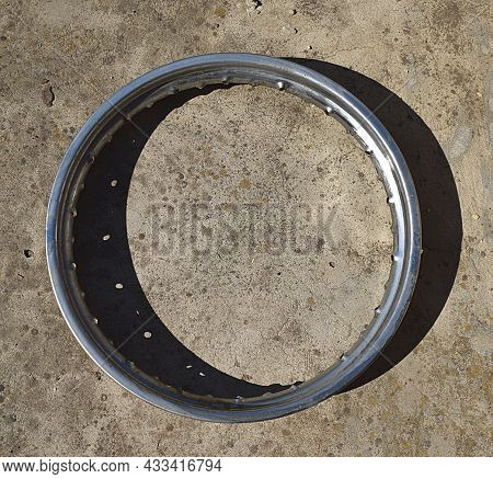 The Chrome-plated Rim Of A Motorcycle Wheel Is Damaged By Rust.