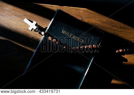 The diverse religious shoot of a cross on a bible