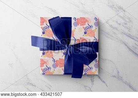 Floral gift box colorful roses paper wrap with blue ribbon
