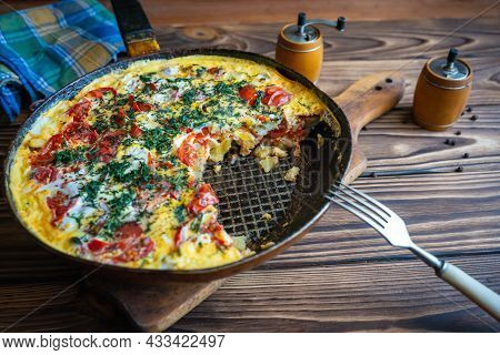 Homemade Food, Fried Potatoes In A Pan With Tomatoes And Eggs.