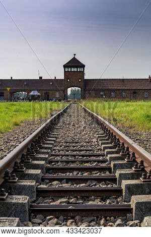 View Of The Gatehouse And Train Tracks At Auschwitz Concentration Camp In Poland