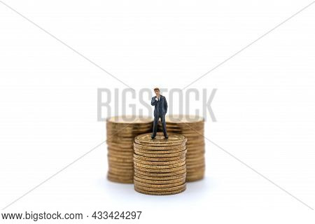 Business, Money Investment And Planning Concept. Businessman Miniature Figure People Figure Standing