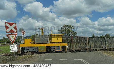 Train Haulage Of Empty Sugarcane Bins Crossing The Road From Factory To Farmers