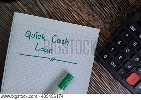 Quick Cash Loan Write On A Book With Keywords Isolated On Wooden Table.