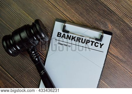 Bankruptcy - Chapter 13 Write On A Paperwork Isolated On Wooden Table.
