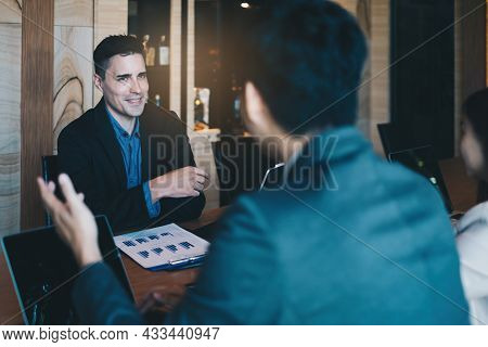 During A Job Interview, A Man In A Suit And Gives A Presentation About Himself