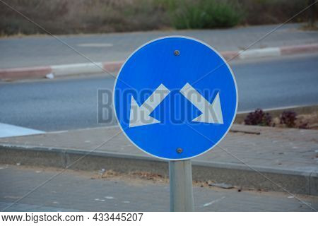 Traffic Direction Sign 'pass Either Side'. Pass Designated Place On Right Or Left Sign. Mandatory Si