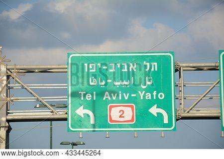 Traffic (road) Sign To Tel Aviv. Tel Aviv To Haifa, Highway 2 In Israel. Trilingual Road Sign In Isr