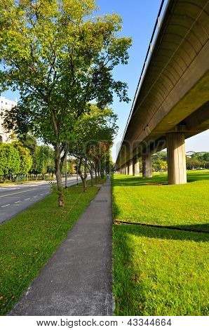 Perspective view of walkway and elevated train tracks at Yio Chu Kang (Singapore) on a sunny day poster