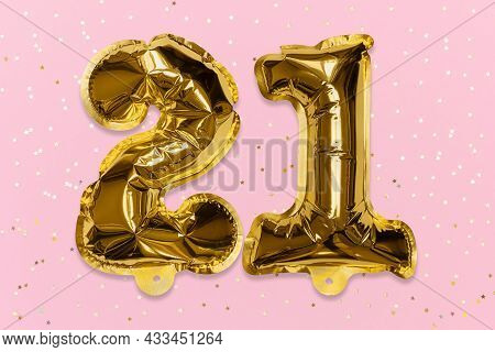 The Number Of The Balloon Made Of Golden Foil, The Number Twenty-one On A Pink Background With Sequi