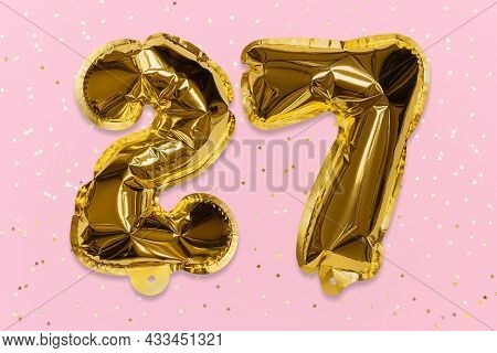 The Number Of The Balloon Made Of Golden Foil, The Number Twenty-seven On A Pink Background With Seq